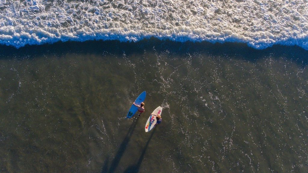 surfers-are-waiting-wave-with-surfboard