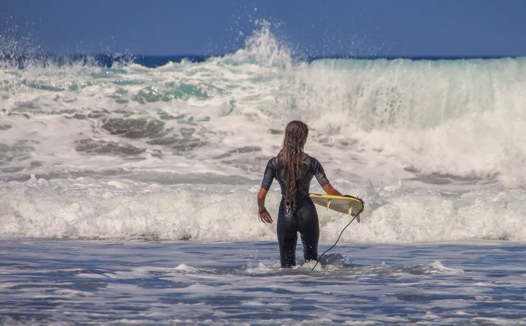 surfer-is-standing-in-shallow